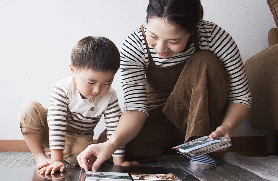 mother playing and teaching her child a mother's role in early childhood development