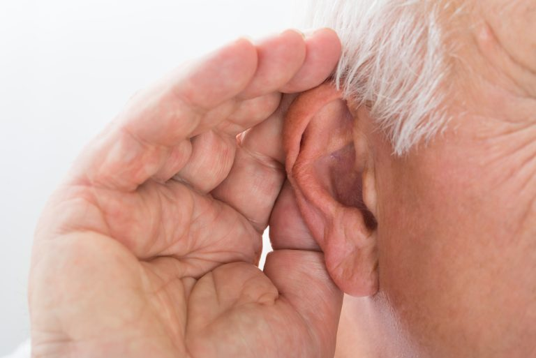 an image showing an elderly having hearing problem or hearing loss