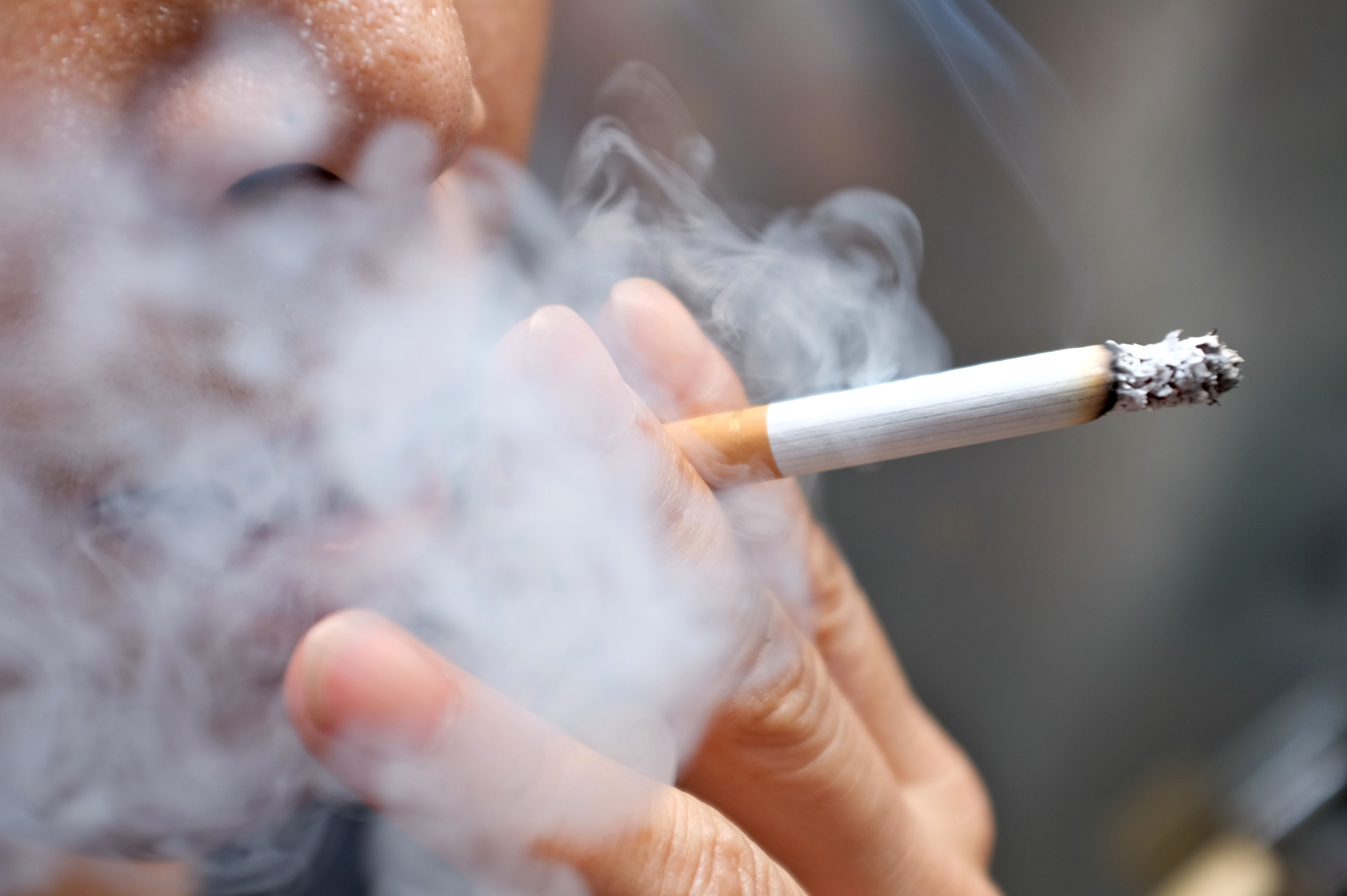 an image of a person smoking for social smoker article